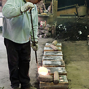 The Valese Foundry was established in the historic center of Venice in 1913. It uses the traditional method of sand casting to produce beautifully crafted items: from the ornaments used to decorate gondolas to the lampposts used to illuminate the Grand Canal; from reproductions of famous monuments to moulds used for glassmaking. The Valese Foundry also produces 'tailor-made' objects and reproductions of complex items such as chandeliers and antique fittings. The excellent quality of its products has attracted prestigious clients including the Hotel Gritti in Venice and the Fox Theater in Atlanta as well artists such as Jean Arp. ..HOW TO LICENCE THIS PICTURE: please contact us via e-mail at sales@xianpix.com or call our offices in Milan at (+39) 02 400 47313 or London   +44 (0)207 1939846 for prices and terms of copyright. First Use Only ,Editorial Use Only, All repros payable, No Archiving.© MARCO SECCHI