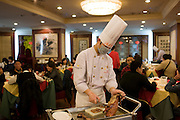Chef prepares Peking duck in Quanjude Roast Duck restaurant, Wangfujing Street, Beijing, China