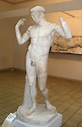 Victorious Athlete Tying a Ribbon.  A Naked youth celebrates victory in athletic competition by binding his head with a victor's ribbon.  This marble Roman statue of around AD 50, copies a lost original Greek sculpture, which would have dated to around 440 BC.  The style of this copy is typical of works attributed to the Greek sculptor Polycleitus.