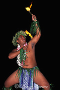 Tahitian fire dancer at hotel feast,<br /> Moorea, Society Islands, French Polynesia, <br /> ( South Pacific Ocean )
