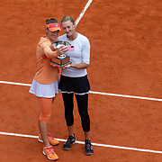 PARIS, FRANCE October 11.  Time Babos of Hungary and Kristina Mladenovic of France pose for a selfie with the trophy after their victory against Alexa Guarachi of Chile and Desirae Krawczyk of the United States in the Women's Doubles Final on Court Philippe-Chatrier during the French Open Tennis Tournament at Roland Garros on October 11th 2020 in Paris, France. (Photo by Tim Clayton/Corbis via Getty Images)