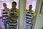 "24 MARCH 2004 - PHOENIX, AZ, USA: Juveniles sentenced as adults line up in their cells during morning cell county in the Maricopa County Jail in Phoenix, AZ, March 24, 2004. The juveniles volunteer to serve Maricpoa County Sheriff Joe Arpaio's chain gang. The sheriff, who claims to be ""the toughest sheriff in America,"" has chain gangs in both the men's and women's jails and now has a chain gang for juveniles sentenced and serving time as adults in the county jail system. The sheriff claims it is the only juvenile chain gang in the country.   PHOTO BY JACK KURTZ"