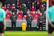 One minute silence, Remembrance Day, Middlesbrough first team coach Ronnie Jepson, Middlesbrough manager Neil Warnock, Middlesbrough assistant manager Kevin Blackwell before the EFL Sky Bet Championship match between Brentford and Middlesbrough at Brentford Community Stadium, Brentford, England on 7 November 2020.