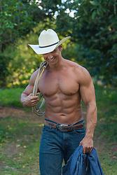 hot muscular shirtless cowboy smiling