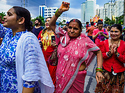"23 SEPTEMBER 2018 - BANGKOK, THAILAND:  Women dance during the Ganesha procession in Bangkok. Ganesha Chaturthi also known as Vinayaka Chaturthi, is the Hindu festival celebrated on the day of the re-birth of Lord Ganesha, the son of Shiva and Parvati. The festival, also known as Ganeshotsav (""festival of Ganesha"") is observed in the Hindu calendar month of Bhaadrapada, starting on the the fourth day of the waxing moon. The festival lasts for 10 days, ending on the fourteenth day of the waxing moon. Outside India, it is celebrated widely in Nepal and by Hindus in the United States, Canada, Mauritius, Singapore, Thailand, Cambodia, and Burma.   PHOTO BY JACK KURTZ"