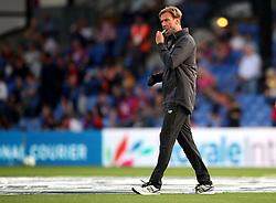 Liverpool manager Jurgen Klopp cleans his glasses before the Premier League match at Selhurst Park, London.