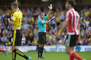 Referee Andre Marriner signals as he gives a free kick to Watford . Barclays Premier League, Watford v Southampton at Vicarage Road in London on Sunday 23rd August 2015.<br /> pic by John Patrick Fletcher, Andrew Orchard sports photography.