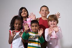 Group of children waving their hands,