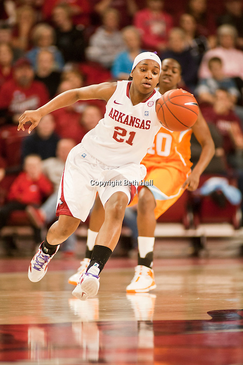 Jan 8, 2012; Fayetteville, AR, USA; Arkansas Razorbacks forward Dominique Robinson (21) chases down a loose ball during a game against the Tennessee Lady Volunteers at Bud Walton Arena. Tennessee defeated Arkansas 69-38. Mandatory Credit: Beth Hall-US PRESSWIRE