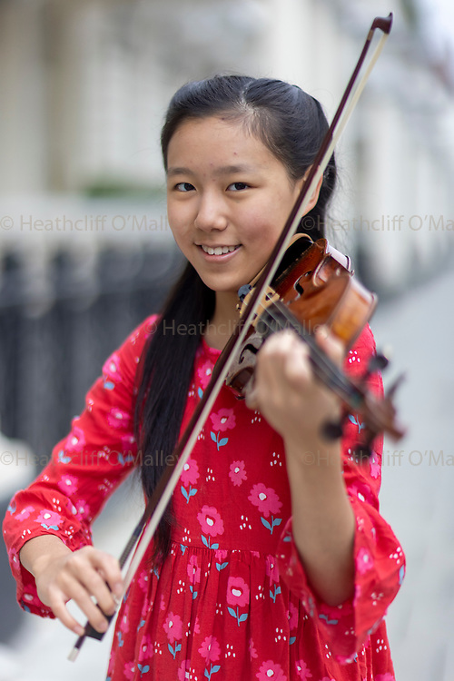 Col0101971 . Daily Telegraph<br /> <br /> DT News<br /> <br /> 14-year-old violinist Leia Zhu has been named as the London Mozart Players' new artist in residence. She will kick off her series of solo engagements with the orchestra on 9 October, performing the Tchaikovsky Violin Concerto at Fairfield Halls in Croydon. <br /> <br /> 2 October 2021