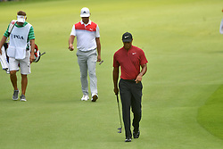 August 12, 2018 - St. Louis, Missouri, U.S. - ST. LOUIS, MO - AUGUST 12: Gary Woodland and Tiger Woods walks up to the #1 green during the final round of the PGA Championship on August 12, 2018, at Bellerive Country Club, St. Louis, MO.  (Photo by Keith Gillett/Icon Sportswire) (Credit Image: © Keith Gillett/Icon SMI via ZUMA Press)