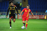 Aaron Ramsey of Wales ® goes past Marouane Fellaini. World cup 2014 qualifying match, Group A, Wales v Belgium at the Cardiff city stadium in Cardiff, South Wales on Friday 7th Sept 2012.  pic by  Andrew Orchard, Andrew Orchard sports photography,