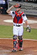 ATLANTA - JUNE 30:  Catcher Brian McCann #16 of the Atlanta Braves gets set for warm up pitches during the game against the Philadelphia Phillies at Turner Field on June 30, 2009 in Atlanta, Georgia.  The Braves beat the Phillies 5-4 in 10 innings.  (Photo by Mike Zarrilli/Getty Images)
