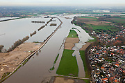 Nederland, Limburg, Gemeente Sittard-Geleen, 15-11-2010; Grevenbicht, Maas (Grensmaas) treedt bij hoogwater buiten zijn oevers en het water wordt ook via de uiterwaarden stroomafwaarts afgevoerd..Maas (Meuse) overflowing its banks, the water is also discharged downstream via the floodplains..luchtfoto (toeslag), aerial photo (additional fee required).foto/photo Siebe Swart
