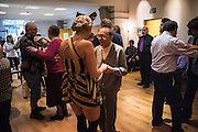 Member of the Bees Knees, danding with over seventies Soho Society Silver Sunday Tea Dance, St. Anne's Church Hall, Soho, London. 2 October 2016