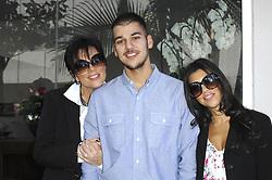 Kris Jenner, Robert and Kourtney Kardashian attend the unveiling of Khloe Kardashian's cheeky new PeTA billboard 'Fur? I'd Rather Go Naked' on Melrose Avenue in Los Angeles, CA, USA on December 10, 2008. Photo by Apega/ABACAPRESS.COM  | 172634_001