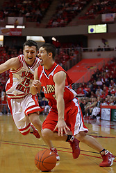 "31 January 2009: Sam Maniscalco runs the baseline looking for the paint with Sead Odzic defending. The Illinois State University Redbirds join the Bradley Braves in a tie for 2nd place in ""The Valley"" with a 69-65 win on Doug Collins Court inside Redbird Arena on the campus of Illinois State University in Normal Illinois"