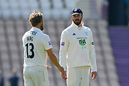 James Vince of Hampshire talks to Gareth Berg of Hampshire during the Specsavers County Champ Div 1 match between Hampshire County Cricket Club and Yorkshire County Cricket Club at the Ageas Bowl, Southampton, United Kingdom on 11 April 2019.