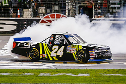 November 2, 2018 - Fort Worth, TX, U.S. - FORT WORTH, TX - NOVEMBER 02: Camping World Truck Series driver Justin Haley (24) slides across the finish line after winning the Jag Metals 350 on November 02, 2018 at Texas Motor Speedway in Fort Worth, Texas. (Photo by Matthew Pearce/Icon Sportswire) (Credit Image: © Matthew Pearce/Icon SMI via ZUMA Press)