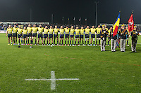 Romania's players, sing their national anthem before the rugby test match between Romania and USA, on National Stadium Arc de Triomphe in Bucharest, November 8, 2014. Romania lose the match against USA, final score 17-27.