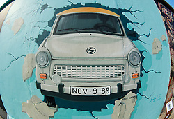 Mural of trabant painted on Berlin Wall at the East Side Gallery in Friedrichshain in Berlin