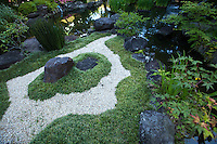 Hasedera temple grounds include an attractive garden and pond, with bamboo water fountain, koi pond and stone lanterns.