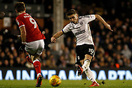 Tom Cairney of Fulham (R) takes a shot at goal. EFL Skybet championship match, Fulham v Barnsley at Craven Cottage in London on Saturday 23rd December 2017<br /> pic by Steffan Bowen, Andrew Orchard sports photography.