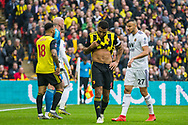 Troy Deeney (Capt) (Watford) wipes his mouth on his shirt during the FA Cup semi-final match between Watford and Wolverhampton Wanderers at Wembley Stadium in London, England on 7 April 2019.
