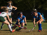 Kellie Ryan and Julia Auld block a shot by Newfound's Hannah Eastman during NHIAA Division III field hockey on Thursday afternoon.  (Karen Bobotas/for the Laconia Daily Sun)