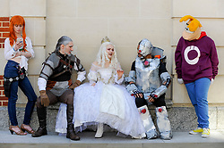 © Licensed to London News Pictures. 08/04/2017. London, UK. (Seated - L to R) An Assassin's Creed character, White Queen from Alice in Wonderland and Cyborg from Justice League join others taking part in the inaugural Games Character Parade, walking from Guildhall to Paternoster Square.  The event formed part of the London Games Festival welcoming cosplayers, wearing costumes inspired by videogame characters, to the UK's biggest parade of cosplayers.   Photo credit : Stephen Chung/LNP