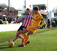Lincoln City's Neal Eardley vies for possession with Northampton Town's Shaun McWilliams<br /> <br /> Photographer Andrew Vaughan/CameraSport<br /> <br /> The EFL Sky Bet League Two - Lincoln City v Northampton Town - Saturday 9th February 2019 - Sincil Bank - Lincoln<br /> <br /> World Copyright © 2019 CameraSport. All rights reserved. 43 Linden Ave. Countesthorpe. Leicester. England. LE8 5PG - Tel: +44 (0) 116 277 4147 - admin@camerasport.com - www.camerasport.com