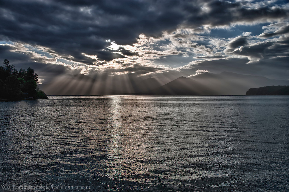 Crepuscular Rays spread over the Olympic Mountain Range and the Hood Canal of Puget Sound Washington state, USA