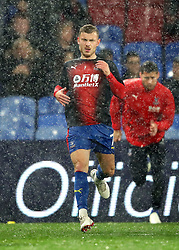 Crystal Palace's Max Meyer (centre) warming up before the Premier League match at Selhurst Park, London.