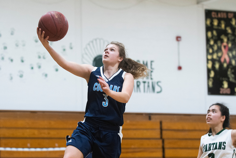 MMU's Caitlyn Luitjens (3) leaps for a layup during the girls basketball game between the Mount Mansfield Cougars and the Winooski Spartans at Winooski High School on Friday night February 14, 2020 in Winooski, Vermont.(BRIAN JENKINS/for the FREE PRESS)
