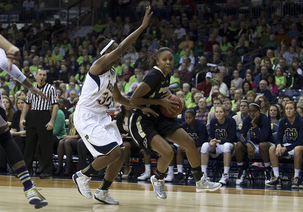 December 29, 2012:  Purdue guard Dee Dee Williams (20) drives to the basket as Notre Dame guard Jewell Loyd (32) defends during NCAA Women's Basketball game action between the Notre Dame Fighting Irish and the Purdue Boilermakers at Purcell Pavilion at the Joyce Center in South Bend, Indiana.  Notre Dame defeated Purdue 74-47.