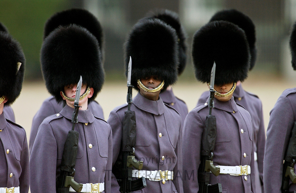 Guardsmen on Parade in winter greycoats, London, UK.