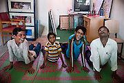 Children suffering from various disorders are exercising with a therapist (right) inside Chingari Trust Rehabilitation Centre, a local NGO caring for disabled children near the abandoned Union Carbide (now DOW Chemical) industrial complex in Bhopal, Madhya Pradesh, India, site of the infamous 1984 gas tragedy. The poisonous cloud that enveloped Bhopal left everlasting consequences that today continue to consume people's lives.
