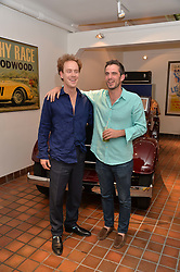 Left to right, TOM INSKIP and JAMIE DUNDAS at the launch of Dundas London held at Fiskins Classic Car Showroom, 14 Queens Gate Place Mews, London on 25th June 2014.