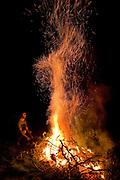 Man burning dead branches in garden fire