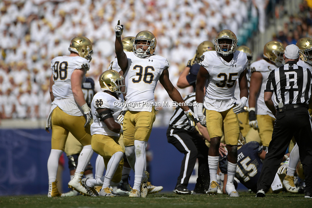 Notre Dame cornerback Cole Luke (36) celebrates after tackling Navy quarterback Will Worth (15) during the second half of an NCAA college football game in Jacksonville, Fla., Saturday, Nov. 5, 2016. Navy won 28-27. (Photo by Phelan M. Ebenhack)