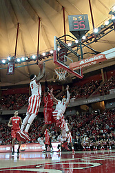 15 February 2014:  Nick Zeisloft gets knocked aside as Jamaal Samuel grabs the rebound from Xzavier Taylor during an NCAA Missouri Valley Conference (MVC) mens basketball game between the Bradley Braves and the Illinois State Redbirds  in Redbird Arena, Normal IL.