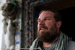 Motorcycle Sherpa's Bear Haughton at a Buddhist temple in Muktinath on the Ride to the Heavens motorcycle adventure in the Himalayas of Nepal. On the fourth day of riding, we went from Kalopani to Muktinath. Thursday, November 7, 2019. Photography ©2019 Michael Lichter.