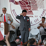 Boxer Myung-Woo Yuh acknowledges the crowd after being inducted into the Hall of Fame during the 2013 International Boxing Hall of Fame induction ceremony on Sunday, June 9, 2013 in Canastota, New York.  (AP Photo/Alex Menendez)