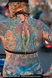 Hilary Rak's incredible full back tattoo on Main Street during the annual Sturgis Black Hills Motorcycle Rally. Sturgis, SD, USA. Tuesday August 8, 2017.  Photography ©2017 Michael Lichter.