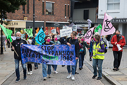 Bishop's Stortford, UK. 29th August, 2020. Climate activists from Extinction Rebellion attend a protest against the expansion of Stansted Airport. The activists are calling on Manchester Airports Group to withdraw their appeal, for which planning permission was previously refused by Uttlesford District Council, to be able to expand Stansted Airport from a maximum of 35 million to 43 million passengers a year, as well as calling on the Government to halt all airport expansion in order to maintain its commitments under the Paris Agreement.