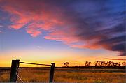 Fence and sunset sky<br /> near Braddock<br /> Saskatchewan<br /> Canada