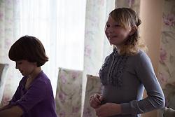 Vika, 10, and Olga, 13, set the table for Olga's birthday celebrations at the Lugansk Orphanage No.1.