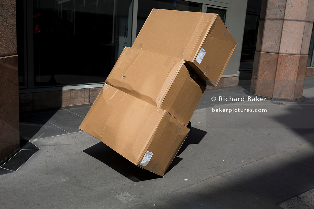 A delivery of large generic cardboard boxes in the City of London, the capital's financial district, on 24th July 2018, in London, England.