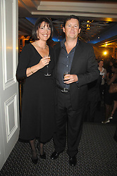 CAROLYN McCALL Chief Executive of the Guardian Media Group winner of the Veuve Clicquot Business Woman Award and her husband PETER FAWLEY at the Veuve Clicquot Business Woman Award held at The Berkeley Hotel, London on 8th April 2008.<br />