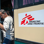 An Iraqi refugee align from the MSF bus that brought him from Molyvos to Mytiline port.
